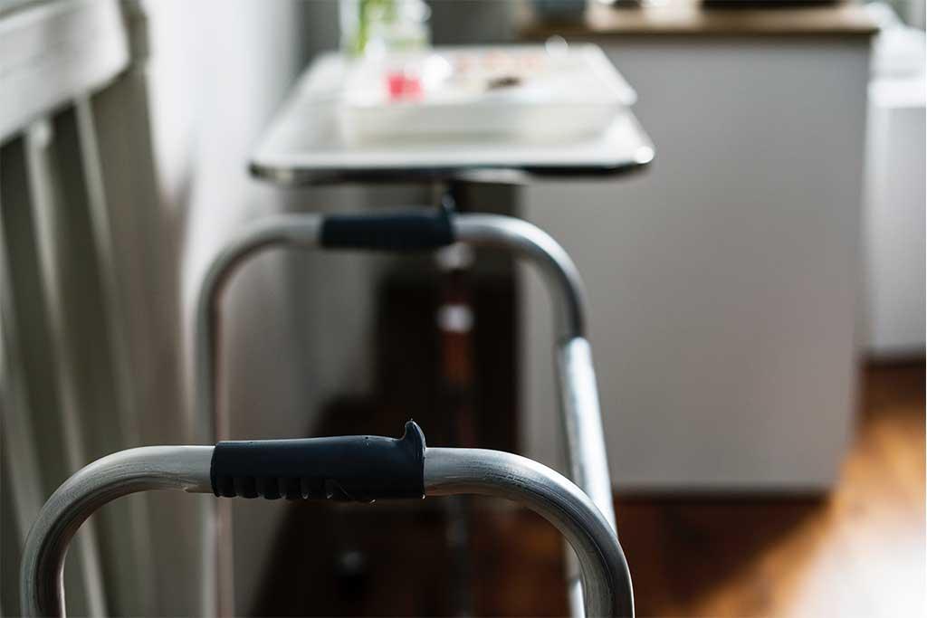 image of walker and nightstand in nursing home