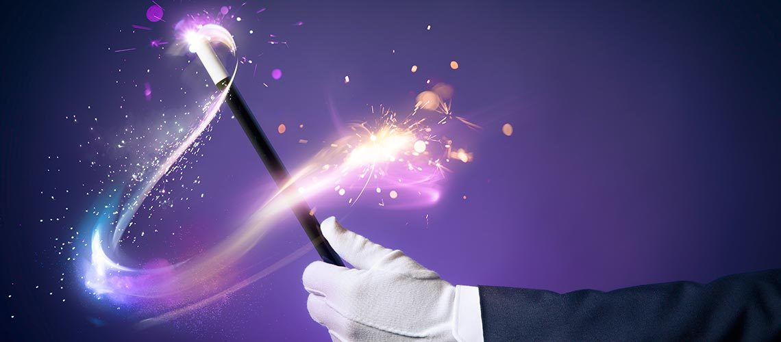 gloved magician swinging wand