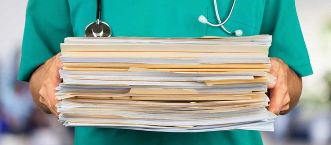 Doctor holding files